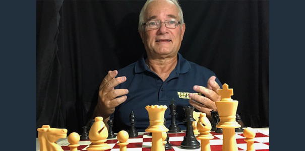 Byron Bridges poses with chess set