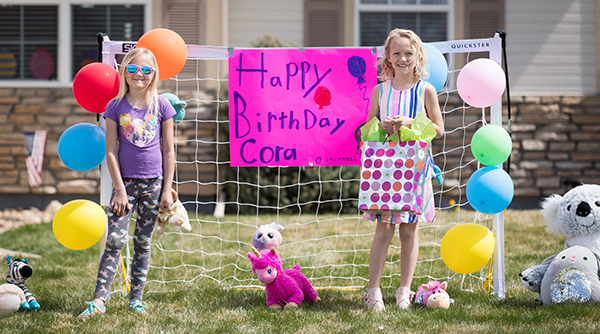 Birthday sign on soccer goal with girls