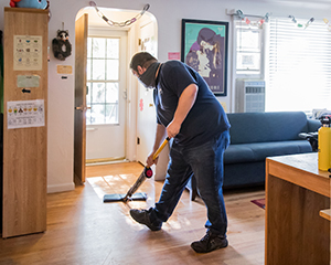 Staff sweeping an office