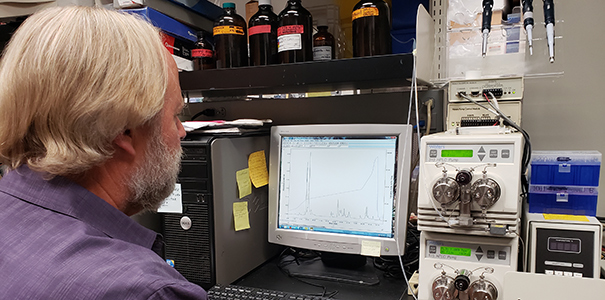 Steve Mackessy using one of his tools in his lab.