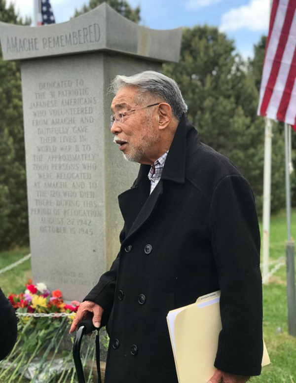 Minoru Tonai speaking at the annual memorial service at the Amache Cemetery in May 2018.