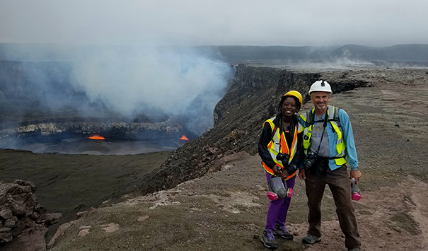 Steven Anderson poses with his graduate student Davitia James over the Kilauea lava lake in Hawaii.