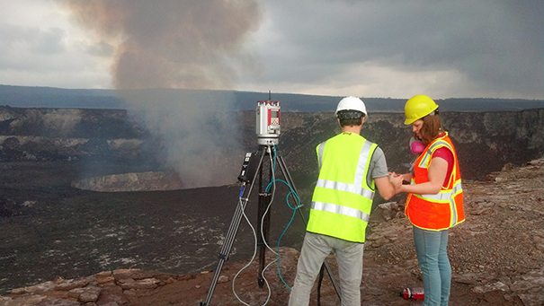 Dr. Anderson's former UNC graduate students Amy Burzynski and Adam Lewnter setting up a LiDAR scanner near the crater.