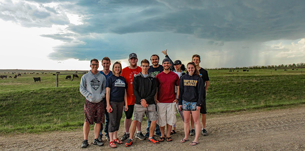 UNC students in front of a storm they chased in May 2019.