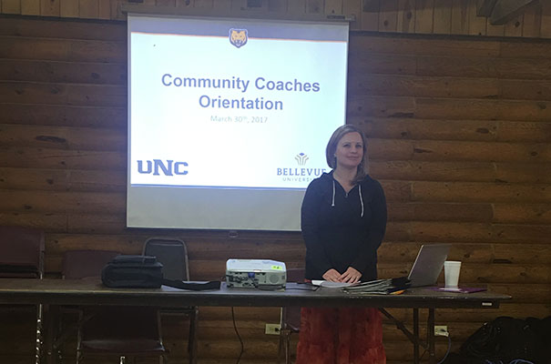 Lauren Rankin presents the Community Coaches program in March at Oglala Community College in Eagle Butte, South Dakota. She and fellow researchers met and discussed the program with the program's mentors who will be paired with court-involved Native Americans. Photo courtesy of David Hulac