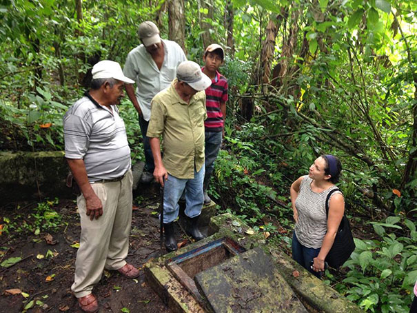 Sarah Romano at a well with water committee members in Nicaragua