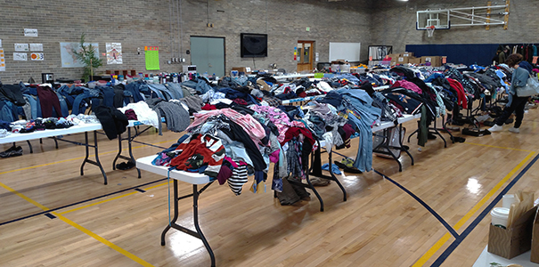 Clothes on tables at past CSC Yard Sale