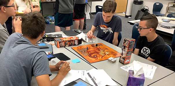Game Studio Design participants learning about and playing a game to better understand the logistics.