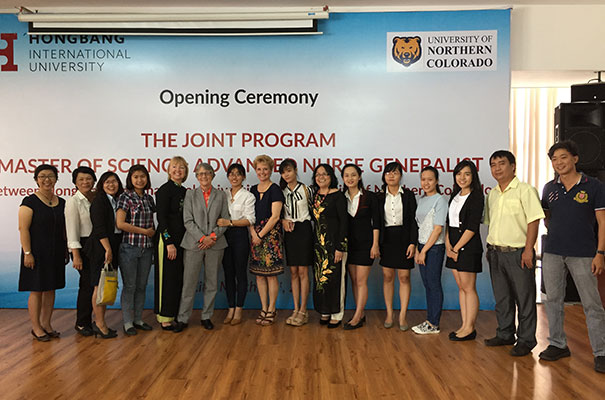 Students in the new program join UNC School of Nursing Director Faye Hummel, fifth from left, Provost Robbyn Wacker, next to Hummel, and Assistant Professor Katrina Einhellig during an introductory ceremony Friday in Ho Chi Minh City.
