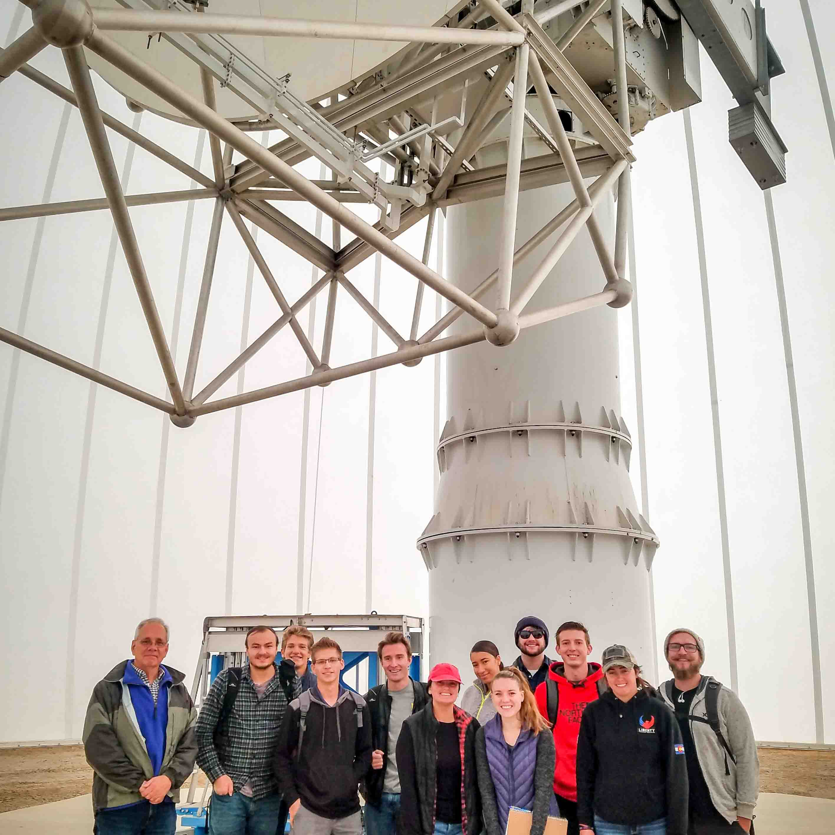 Meteorology students with the CSU-CHILL radar and the facility manager, Pat Kennedy