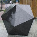black stone icosahedron in the rain