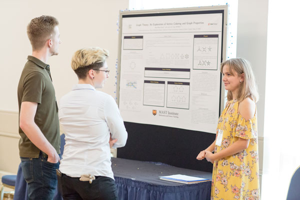 Maya presenting her research