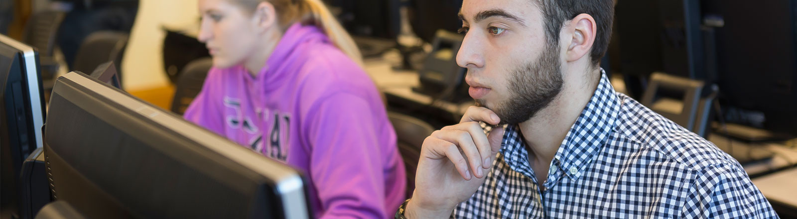 Student deep in thought at computer