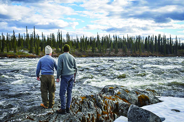 Dunn and Cleason scout rapids near the Arctic Circle