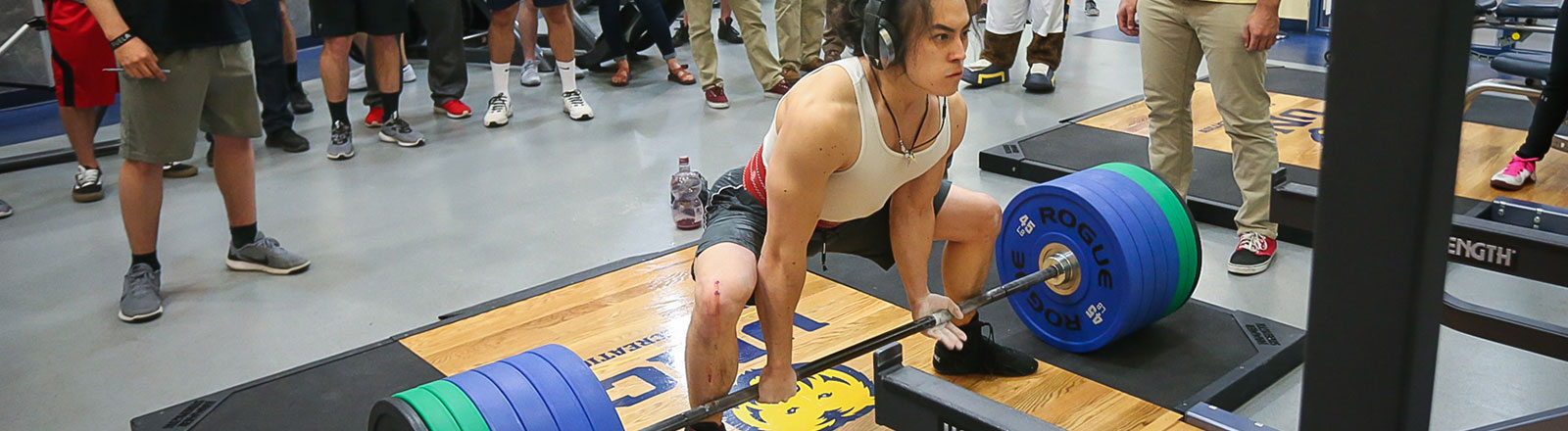 Student powerlifting in the recreation center