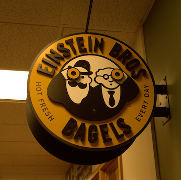 Einsteins Bagel Compnay sign hanging in the UC