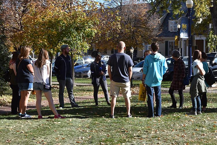 Students talking around Northern Vision Sculpture