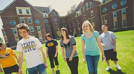 Transfer Students Walking on the Grass